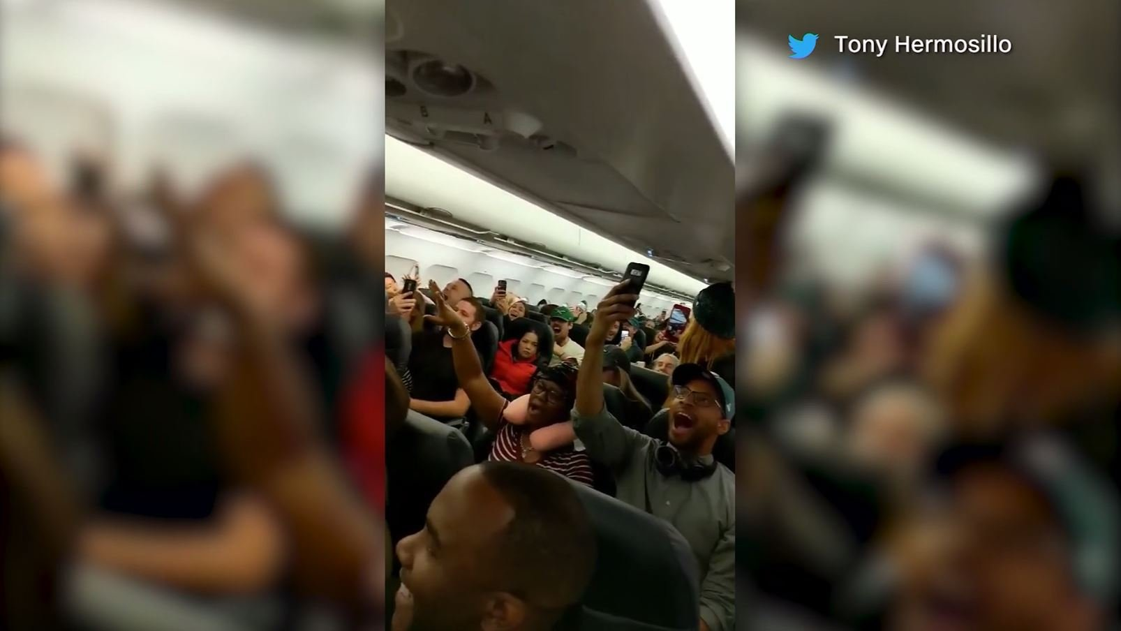 Cellphone videos captured planes full of Eagles fans belting out the team's fight song. (Source: CNN/Tony Hermosillo/Twitter, Katie Wilusz/Twitter)