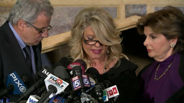 Sharon Bialek, center, has accused Cain of reaching under her skirt. (Source: CNN)