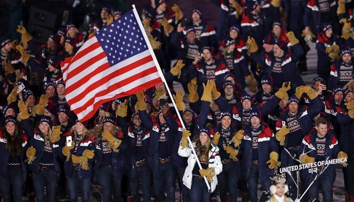 Erin Hamlin carries the flag of the United States during the opening ceremony of the 2018 Winter Olympics in Pyeongchang, South Korea, Friday, Feb. 9, 2018. (AP Photo/Michael Sohn)