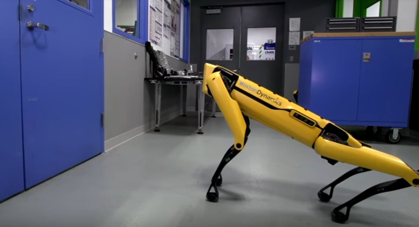 "Boston Dynamics uploaded a video to its YouTube channel showcasing the dexterity and problem-solving ability of a robot called the ""SpotMini,"" which can hold doors open for robot companions to walk through. (Source: Boston Dynamics/YouTube)"