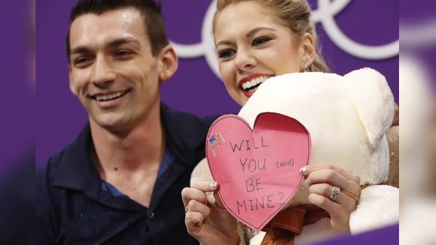 Alexa Scimeca Knierim and Chris Knierim of the USA react as they wait for their scores to be posted following their performance in the pair figure skating short program at the 2018 Winter Olympics, Wednesday, Feb. 14, 2018. (AP Photo/Bernat Armangue)