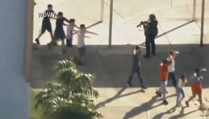 Police evacuate students. (Source: WSVN/CNN)