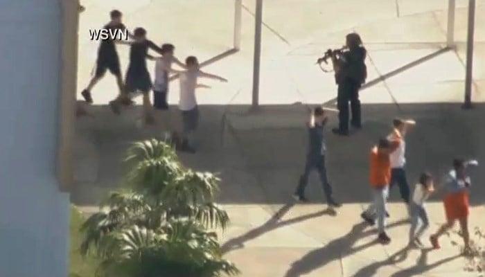 Police evacuate students. (Source: WSVN/CNN)