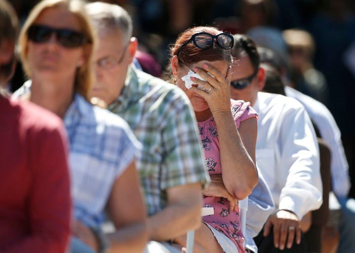 Attendees react at a prayer vigil for the victims of the shooting at Marjory Stoneman Douglas High School. (Source: AP Photo/Wilfredo Lee)