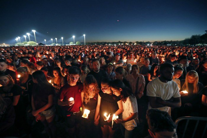 (AP Photo/Gerald Herbert) People attend a candlelight vigil for the victims of the Wednesday shooting at Marjory Stoneman Douglas High School, in Parkland, Fla., Thursday, Feb. 15, 2018. Nikolas Cruz, a former student, was charged with 17 counts of ...