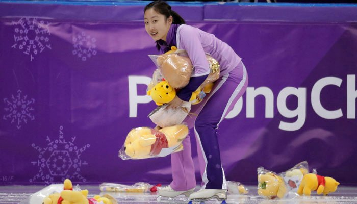 A skating girl collects Winnie The Pooh toys off the ice in the Gangneung Ice Arena at the 2018 Winter Olympics in Gangneung, South Korea, Friday, Feb. 16, 2018. (AP Photo/Julie Jacobson)