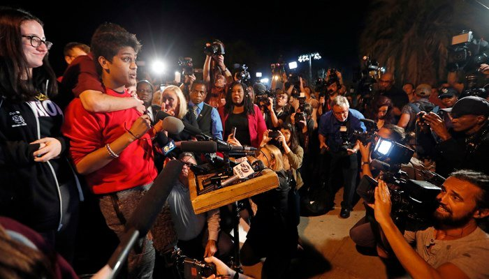 Tanzil Philip, 16, a student survivor from Marjory Stoneman Douglas High Schoo speaks to a crowd of supporters and media at Leon High School, in Tallahassee, Fla. (AP Photo/Gerald Herbert)