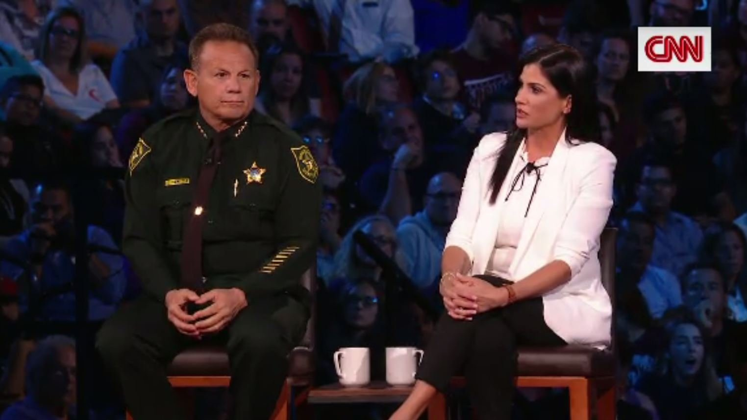 Second Amendment supporter Dana Loesch spoke with students and families affected by the Marjory Stoneman Douglas High School shooting at a CNN town hall on Wednesday, as Broward County Sheriff Scott Israel sat near. (Source: CNN)