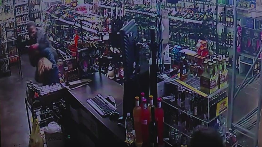 The shocking moment mother and daughter fight off armed robber