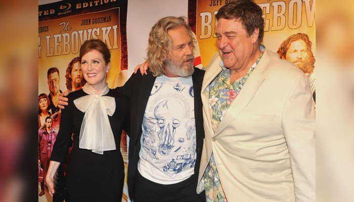 Actors Julianne Moore, Jeff Bridges, center, and John Goodman arrive at a cast reunion celebrating 'The Big Lebowski' Limited Edition Blu-ray release on Aug. 16, 2011, in New York. (Diane Bondareff/AP Images for Universal Studios Home Entertainment)