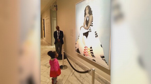 A photo of a toddler staring at the portrait of former FLOTUS Michelle Obama started a social media frenzy. (Source: BEN HINES/JESSICA CURRY/CNN)