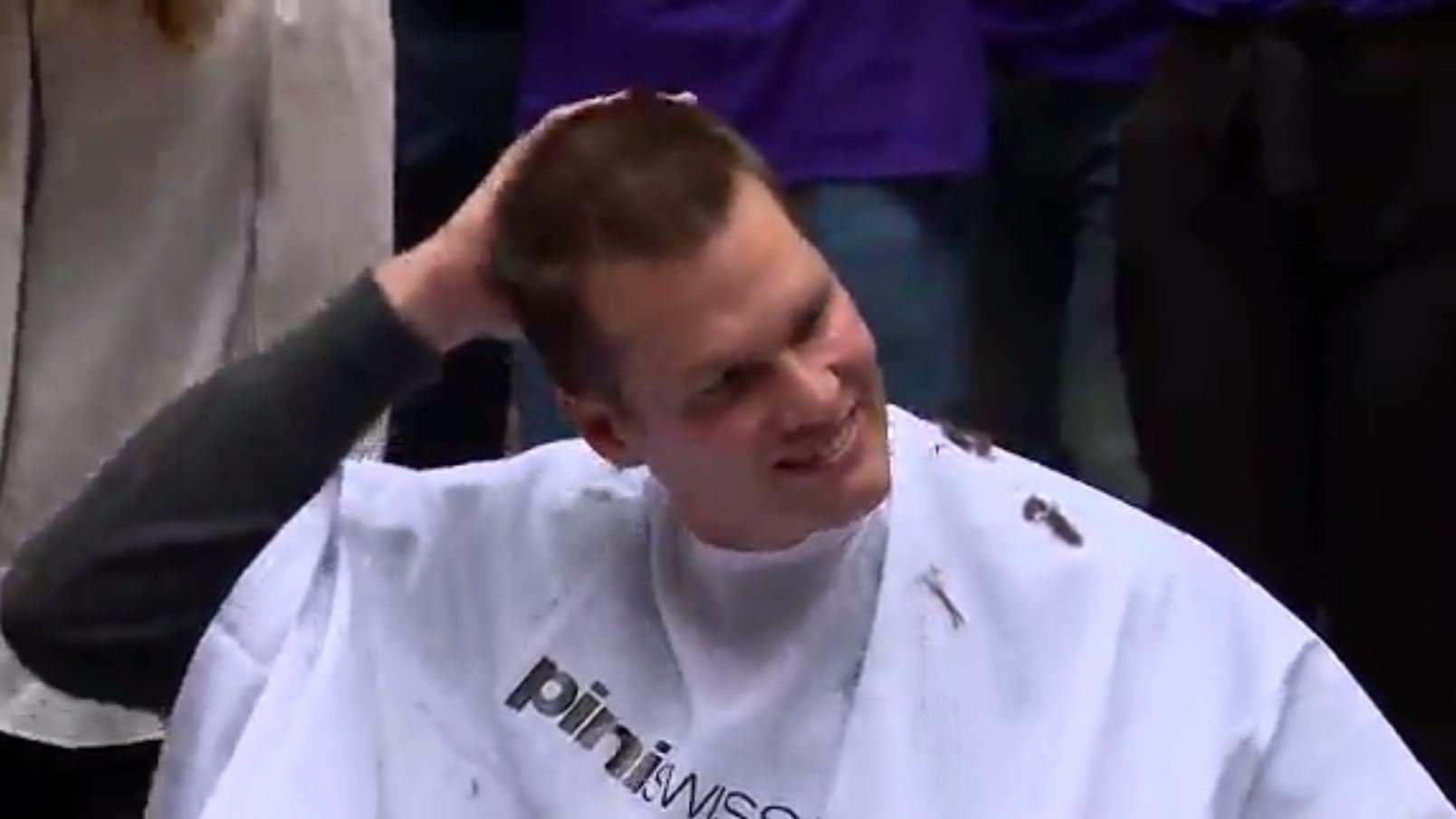 Quarterback Tom Brady got a buzz cut at the Granite Telecommunications building in Quincy, MA, on Thursday to raise money for the Dana-Farber Cancer Institute. (Source: WCVB/CNN)