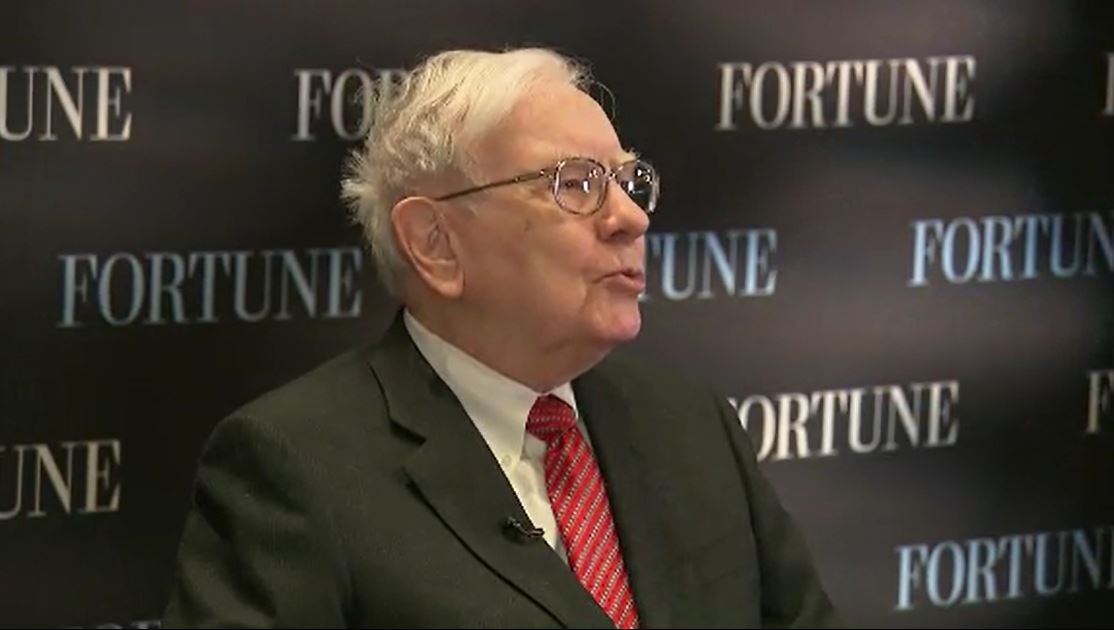 Warren Buffett offers $1 million or $2 million for life to employee who can picks a perfect March Madness bracket. (Source: CNN)