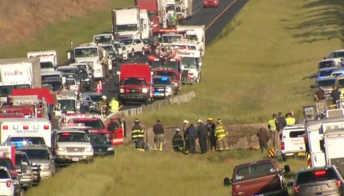 A charter bus carrying high school students crashed into a ravine about 20 miles east of Mobile, AL. At least 40 were injured. (Source: Jesus Tejeda/CNN)
