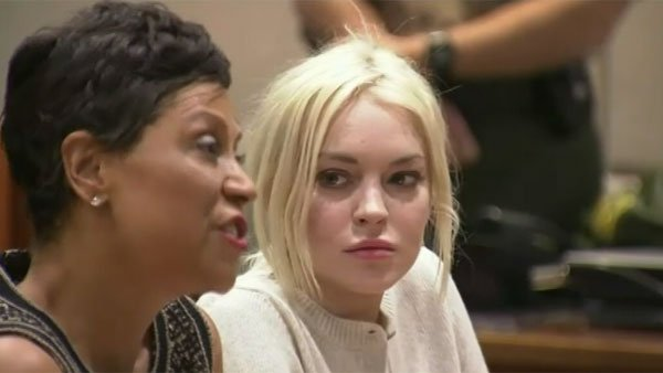 Lindsay Lohan is represented by attorney Shawn Chapman Holley, left. (Source: CNN)