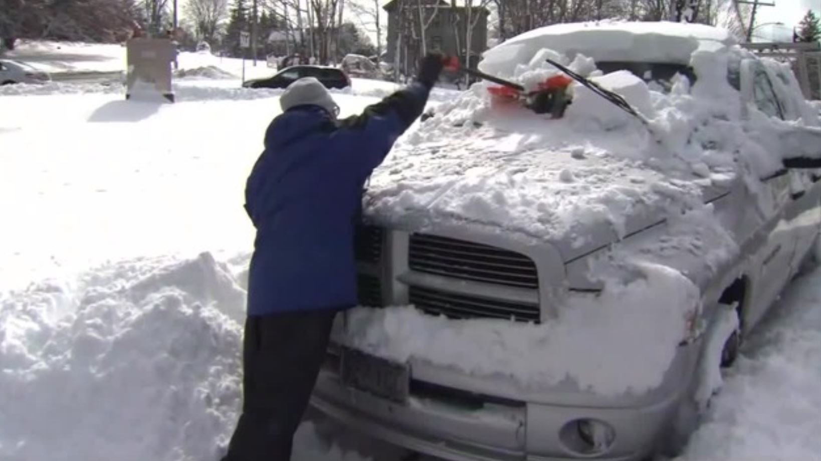 On Wednesday, March 14, a resident of Methuen, MA, clears away snow that fell as the result of a nor'easter moving along the Atlantic coast. (Source: WBZ/CNN)
