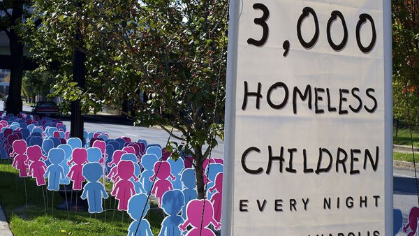 A sign in Indianapolis shows the extent of the problem in that city alone. Three thousand children are homeless every night in the city. (Source: sciondriver, Flickr)