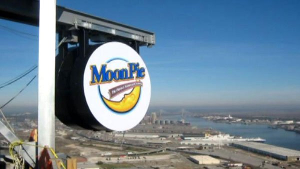 The giant MoonPie sits atop the RSA BankTrust Building before taking its big dive. (Source: WSFA)