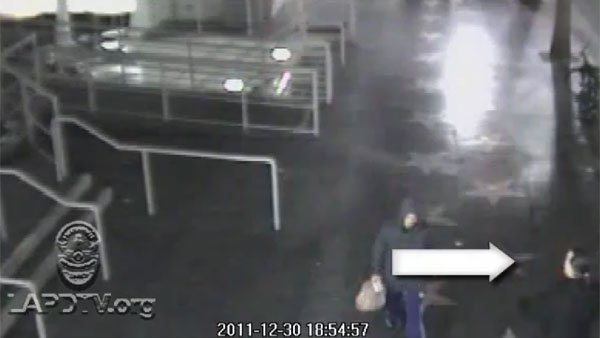 Surveillance footage released by the LAPD shows a man with a ponytail near the scene of suspected arsonous fires Friday night. (Source: Los Angeles Police Department)