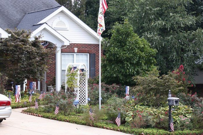 Janice and Carl's front yard is planted with flowers and plants instead of grass, going against a St. Peters ordinance that says 50 percent of their yard must be grass. (Source: David Rowland)