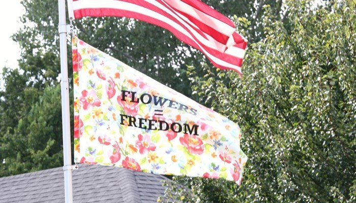 The flag taking the Duffners point of view against the city flies in their yard. (Source: David Rowland)