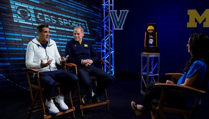 "(AP Photo/David J. Phillip) Villanova head coach Jay Wright, left, and Michigan head coach John Beilein talk to Tracy Wolfson during an interview for CBS Sports Network's ""We Need to Talk"" show before the championship game of the Final Four..."