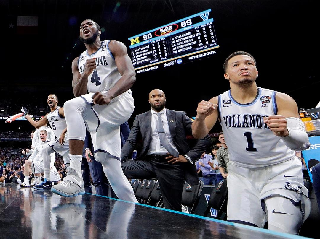 (AP Photo/David J. Phillip) Villanova's Jalen Brunson (1), Eric Paschall (4) and players on Villanova bench react to a 3-point basket during the second half in the championship game of the Final Four NCAA college basketball tournament against Michigan, Mo