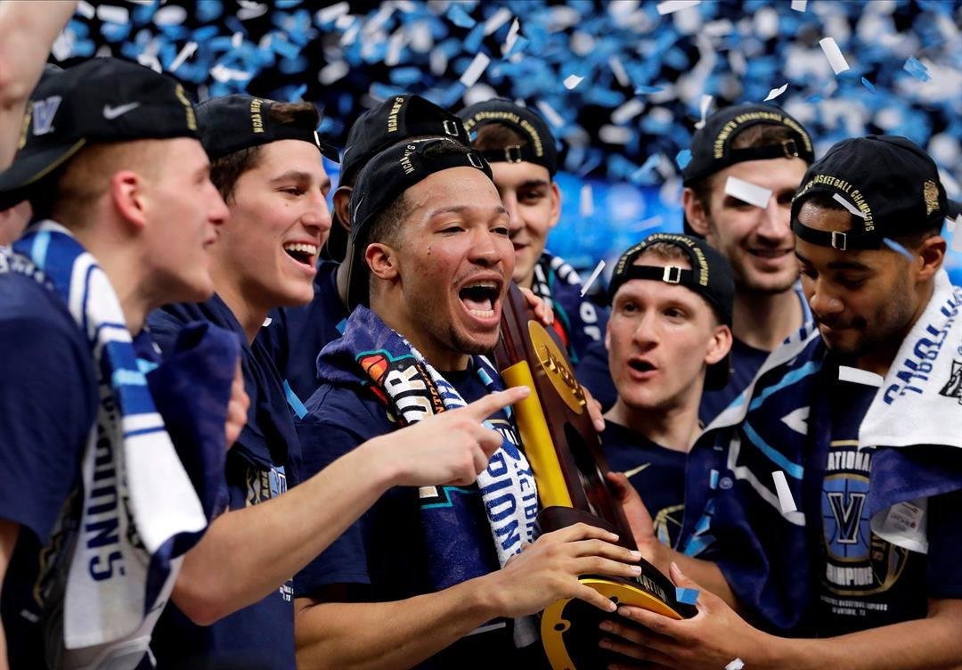 (AP Photo/Eric Gay) Villanova guard Jalen Brunson, center, celebrates with teammates after beating Michigan 79-62 in the championship game of the Final Four NCAA college basketball tournament, Monday, April 2, 2018, in San Antonio.