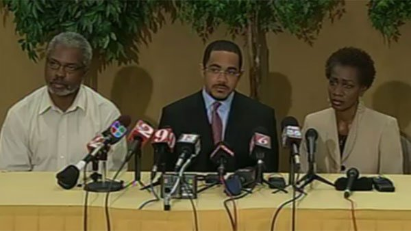 From left, Robert Champion Jr.'s father, Robert Champion, family attorney Christopher Chestnut and Robert Jr.'s mother, Pam Champion speak to reporters in Orlando, FL. (Source: Central Florida News 13/CNN)