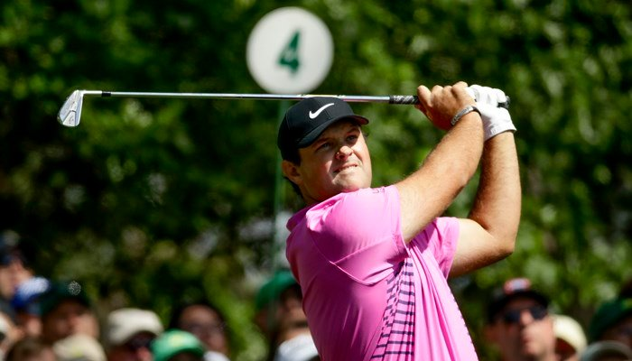 Patrick Reed hits on the fourth tee during the fourth round at the Masters golf tournament Sunday, April 8, 2018, in Augusta, GA. (AP Photo/Chris Carlson)