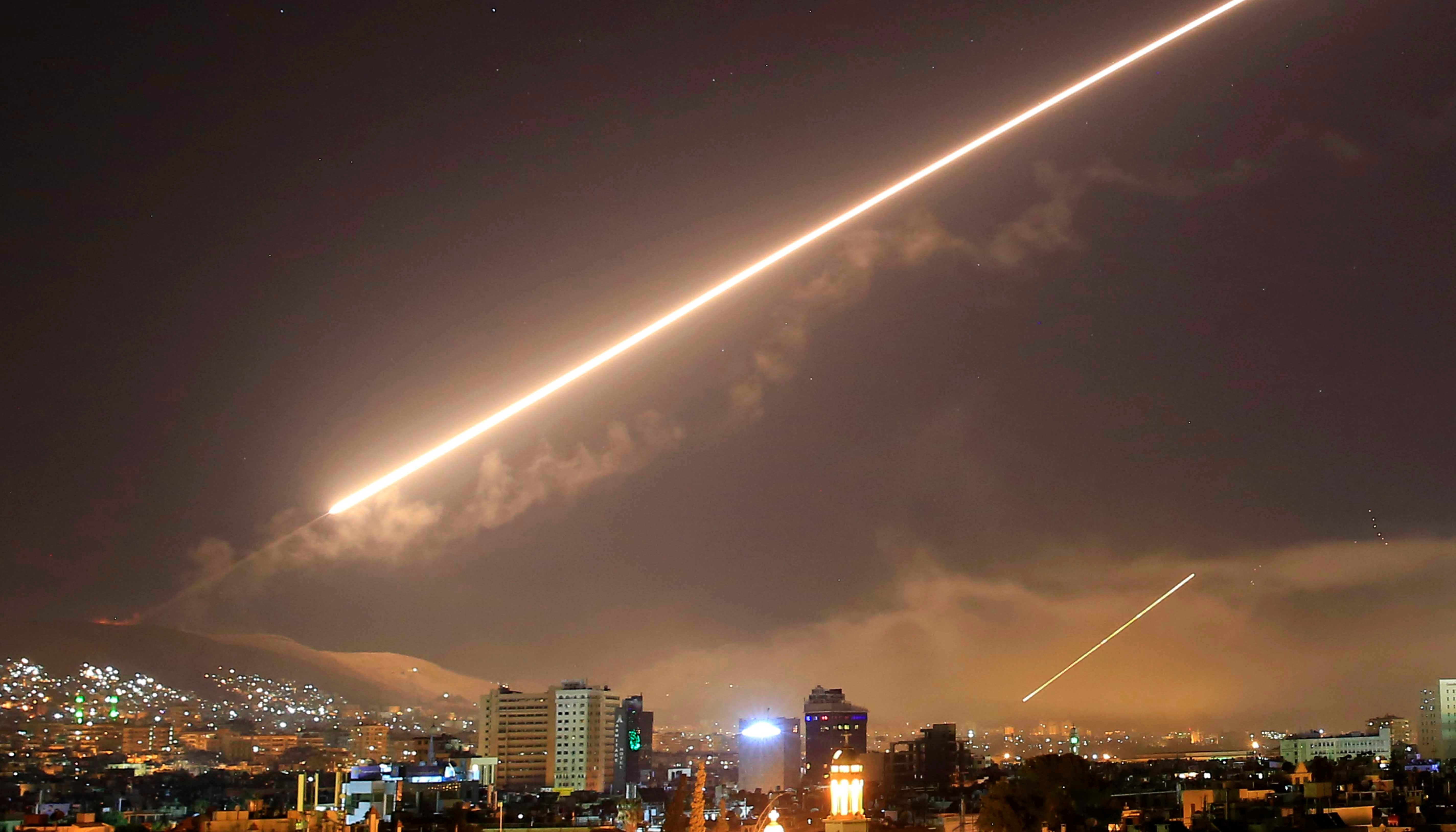 The sky over Syria's capital, Damascus, lights up with surface-to-air missile fire as the U.S. launches an attack on Syria. President Trump announced airstrikes in retaliation for the country's alleged use of chemical weapons. (AP Photo/Hassan Ammar)