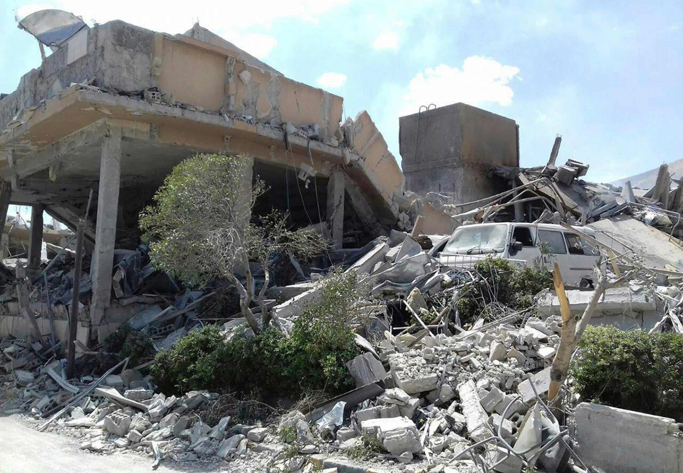 This image shows the damage to the Syrian Scientific Research Center which was attacked by U.S., British and French military strikes Friday. (Source:SANA/AP Photos)
