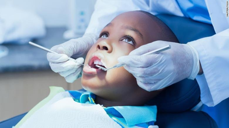 Fewer dental cavities are found in kids and young adults. Even so, some minority groups are still most at risk. (Source: CNN)