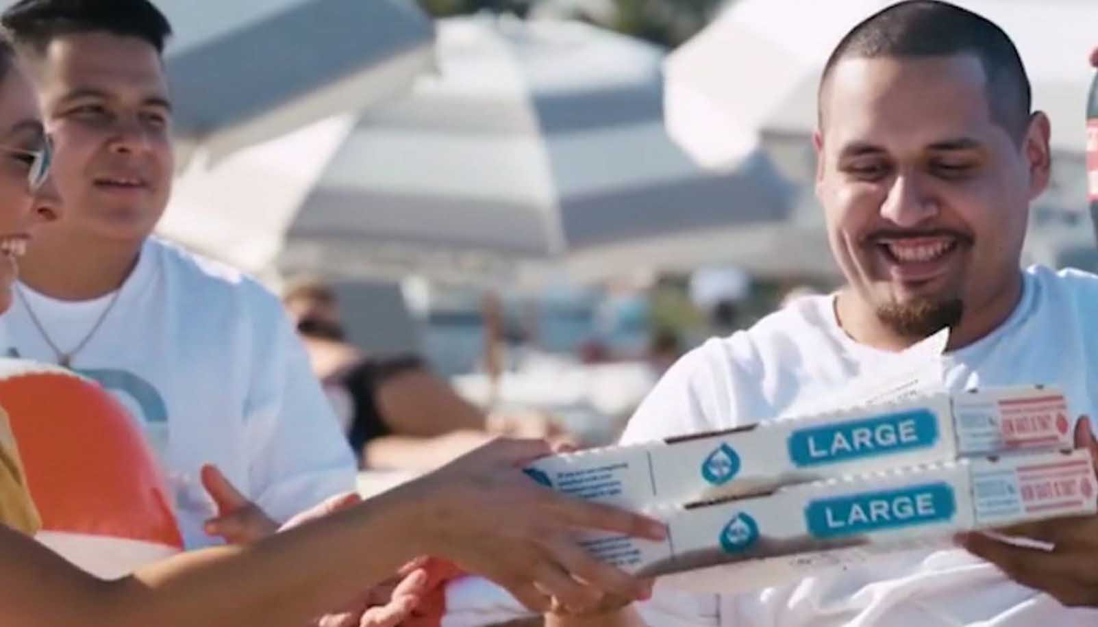 Domino's will now bring a pizza to you at a beach or a park. (Source: CNN/Domino's)
