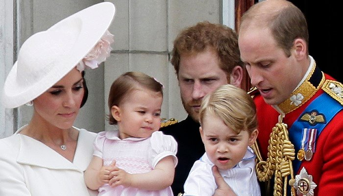 In this 2016 file photo, Prince William holds Prince George, right and Kate Middleton holds Princess Charlotte, left, at Buckingham Palace, in London. (Source:AP Photo/Tim Ireland, File)