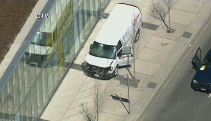 Police are investigating if the van intentionally or accidentally jumped the curb in Toronto. (Source: CTV)