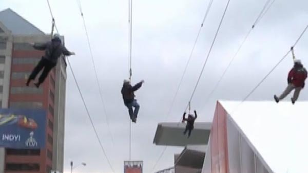A grandmother decided to zipline at a pre-Super Bowl event. (Source: WXIN/CNN)