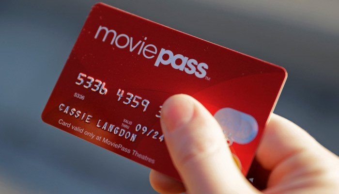 MoviePass, a startup that lets customers watch a movie a day at theaters for just $10 a month, is limiting new customers to just four movies a month. (Source: Darron Cummings/AP)
