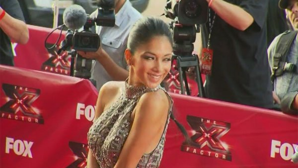 Nicole Scherzinger signed on to 'The X Factor' as a co-host before replacing British singer Cheryl Cole. (Source: CNN)