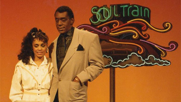 Singer and songwriter Rainy Davis, left, stands with Don Cornelius, the original host of the televised dance party 'Soul Train.' (Source: Rainysongs/wikiCommons)