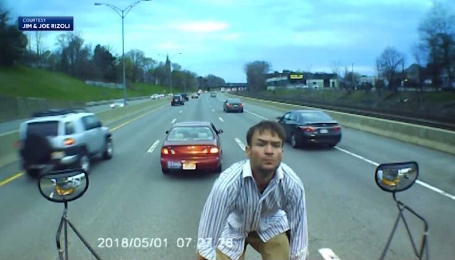 Video captures man jumping on school bus in middle of turnpike