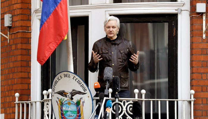 WikiLeaks founder Julian Assange gestures as he speaks on the balcony of the Ecuadorian embassy, in London. (Source: AP Photo/Matt Dunham)