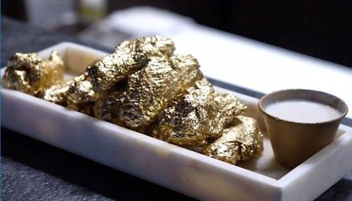 "The Ainsworth restaurant in New York paired up with ""Foodgod"" Jonathan Cheban to create 24-karat gold wings. (Source: The Ainsworth/CNN)"