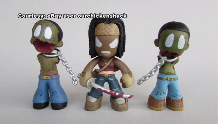 "A black customer took offense to ""Walking Dead"" toys on the desk of a white employee. (Source: WNCN/EBay/Funko/CNN)"