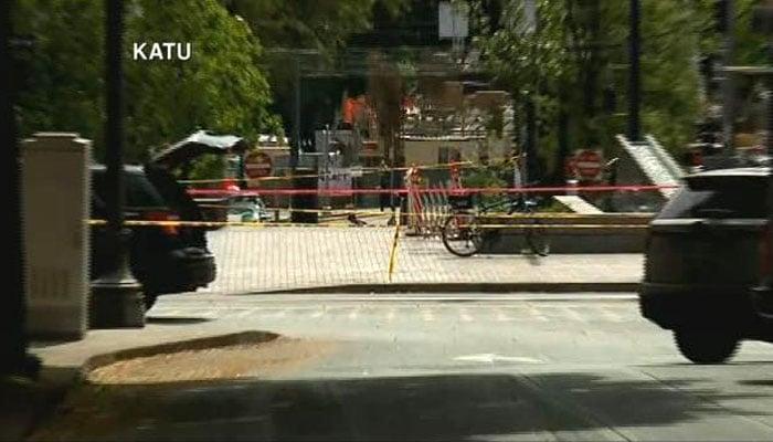 Three women were injured when a dark SUV hit them as they stood on a sidewalk in Portland, OR. (Source: KATU/CNN)