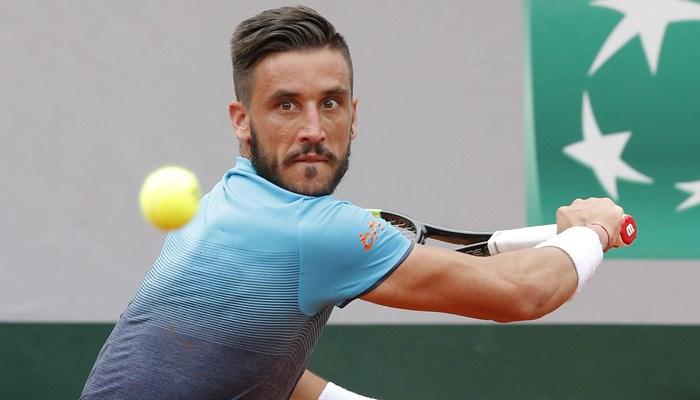 Damir Dzumhur returns a shot during the French Open. (Source: Michel Euler/AP)