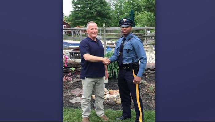 Traffic stop reunites trooper with retired cop who delivered him