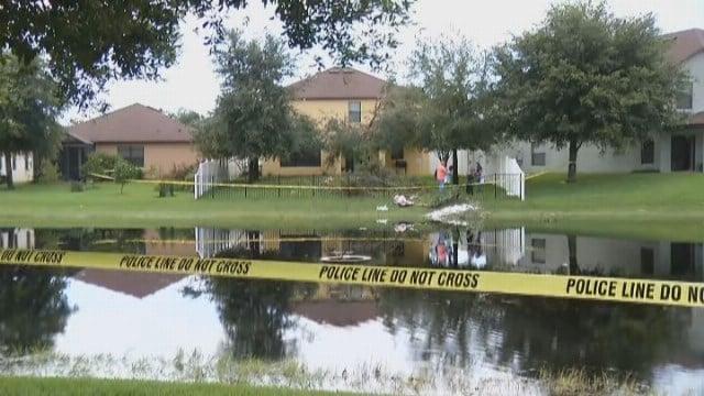 A small plane struck two homes before crashing into a pond in Daytona Beach, Florida. (Source: WKMG/CNN)