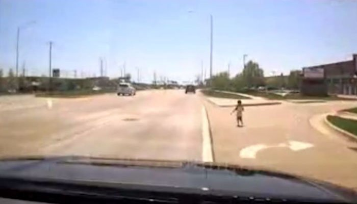 Cop scoops up toddler trotting on busy highway