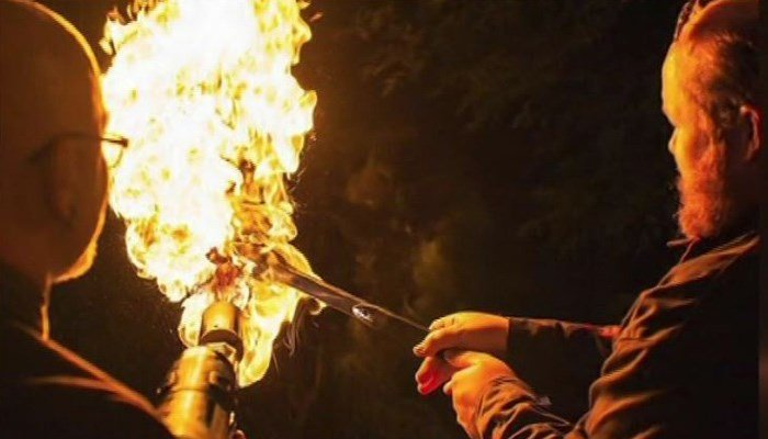 The billionaire tweeted a warning over the weekend, reminding people to use the flamethrowers 'as directed to avoid unintentionally burning things down.' (Source: YouTube/KCAL/KCBS/CNN)